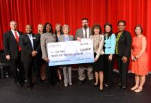 Eric Patin with Milken Award check