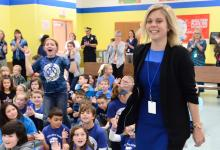Erin Quinlan cheered by students