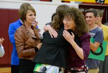 Jane Foley hugs Gina Benz
