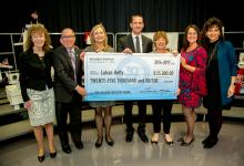 Lukas Hefty check with Milken Educator vets