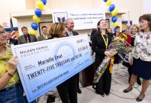 Marielle Emet receives check and cheers